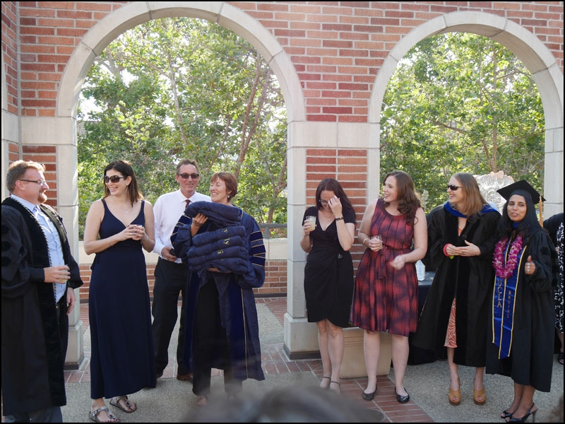 Five of the six recent graduates in Egyptian archaeology are acknowledged during the reception on the roof of the Fowler Museum.